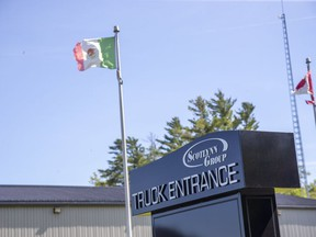 A Mexican flap flies outside of ScotLynn Group, a farm operation that produces corn, watermelon, asparagus and pumpkins in Vittoria, Ont. Migrant workers there have tested positive for COVID-19. Derek Ruttan
