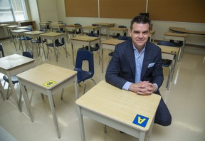 Mark Fisher, Director of Education and CEO of Thames Valley District School Board sits at a classroom desk at Eagle Heights public school. (Derek Ruttan/The London Free Press)