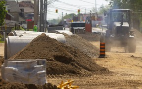 In late May, work continued on the project to separate sanitary and storm sewers in the Hamilton Road and Egerton Street area, one of the things the city is doing to reduce river pollution amid more intense and frequent storms expected from climate change. Much of city council's environmental action plan has been delayed by the pandemic. (Mike Hensen/The London Free Press)