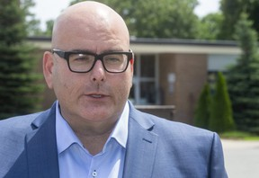 Steven Del Duca, the leader of the Ontario Liberal party talks about the Doug Ford back to school plan in front of St. Mark Catholic elementary school in London, Ont.  (Mike Hensen/The London Free Press)