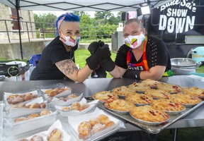 Jude Anderson-Clutz of The Welsh Baker  and Lynn Lavoie, of the Gen3 baking team put their desserts to the test.  Anderson-Clutz puts her Italian Bomboloni against Lavoie' fruit pies at the Bake Sale Showdown, filmed Friday, Aug. 28 in Springbank Park. The bake sale is Saturday morning, with the winner of the reality TV series being the team that sells the most baked goods for charity. (Mike Hensen/The London Free Press)