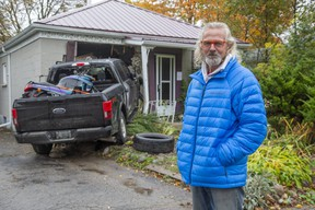 Hubert Van Niekerk stands in front of his rental property at 30 Elliot St. in London on Monday October 19, 2020. Nobody was inside the east-end house when it was struck by a stolen pickup truck Monday morning, police say.