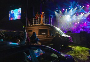 Eric Ethridge and Kalsey Kulyk perform on top of a van at the Country Music Association of Ontario Awards at Western Fair in London.  Photograph taken on Sunday October 4, 2020.  (Mike Hensen/The London Free Press)