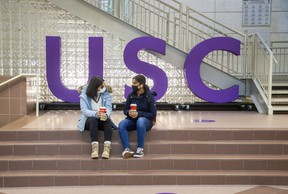 First-year Western University students Sogol Noormandi (left) and Maha Khawaja enjoy coffee in the University Community Centre, home of the University Student Council (USC) in London in this November 2020 photo. (Derek Ruttan/The London Free Press)