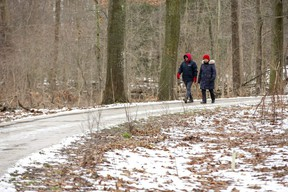"""Miguel and Gladys Rivera of St. Thomas take a stroll through the woods at Pinafore Park in St. Thomas on Monday. """"It's nice to get exercise and see nature,"""" said Gladys. (Derek Ruttan/The London Free Press)"""