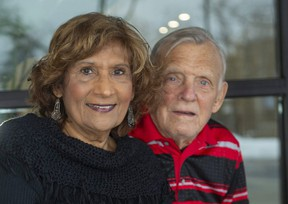 Genia Carter poses with her husband Bryan at their home in London, Ont., on Monday, Dec. 28, 2020. Genia Carter and her 11 siblings captured the Guinness world record for the highest combined age of 12 living siblings on Dec. 15, when their collective age hit 1,042 years, 315 days. (Mike Hensen/The London Free Press)