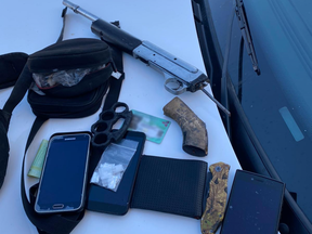 London police seized a sawed-off rifle, ammunition, brass knuckles, small amounts of suspected crystal methamphetamine and suspected fentanyl and cellphones during an arrest Thursday. (Police supplied photo)