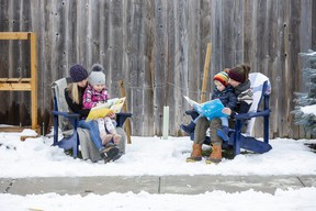 Jill Carrington, left, reads to daughter Adrielle, 4,  and Paige Blay reads to son Felix, 2, in London.  The London Public Library has launched a new program to encourage parents to read 1,000 books to pre-schoolers before they start kindergarten. (Derek Ruttan/The London Free Press)