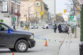 Police investigate after a woman was struck and killed by a vehicle on Clarence Street between York and King streets Friday morning in downtown London. (Derek Ruttan/The London Free Press)