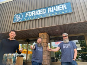 NHLer Logan Couture, left, celebrates the launch of a new beer brewed in London and San Jose in support of his charity with Dave Reed and Andrew Peters of Forked River Brewing. (Contributed)