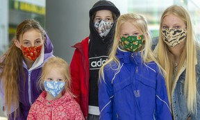The Van De Hoef clan from Strathroy was rocking a whole variety of masks Friday in White Oaks Mall. From left are Emma, 11, Abbie, 4, Ethan, 11, Autumn, 7, and Jordyn, 13. (Mike Hensen/The London Free Press)