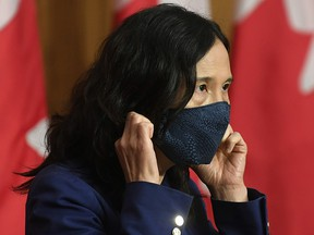Chief Public Health Officer Theresa Tam removes her mask as she arrives for a news conference Friday, October 2, 2020 in Ottawa.