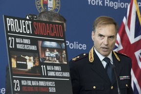 Fausto Lamparelli, of the Italian State Police, Traditional Organized Crime Task Force, speaks to media as York Regional Police held a news conference detailing charges laid in Project Sindacato on Thursday, July 18, 2019. (Stan Behal/Toronto Sun/Postmedia Network)