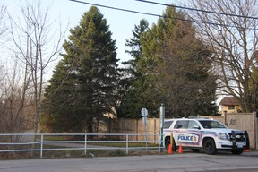 A London police cruiser on Thursday morning was blocking access to a path north of Barker and Huron streets, where police said officers responded the night before to reports of a shooting. The path connects Kipps Lane and Barker Street and backs several single-family homes. JONATHAN JUHA/The London Free Press