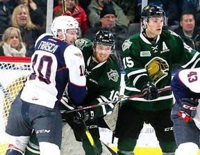 Jordan Frasca, left, of the Windsor Spitfires battles with Kevin Hancock and Cole Tymkin of the London Knights in front of Spitfires goalie Kari Piiroinen at Budweiser Gardens on Friday January 25, 2019 in London. (London Free Press file photo)