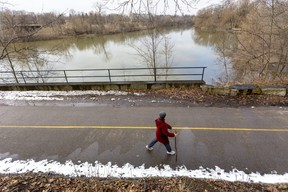 "Lisa Dufour strides along the Thames River between Wonderland Gardens and Greenway Park in London. Dufour says she walks everyday. ""I just love it. I always have and it keeps you in shape."" (MIKE HENSEN, The London Free Press)"