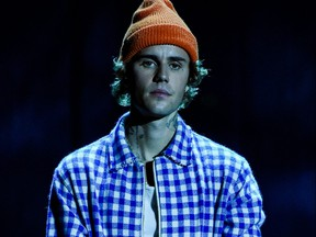 In this handout image courtesy of ABC singer Justin Bieber performs during the 2020 American Music Awards at the Microsoft theatre on Nov. 22, 2020 in Los Angeles.