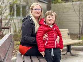 Anabel Lindblad sits with her son, Théo, who is unable to do at-home remote learning.