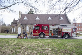 London police and the London fire department investigate a suspicious fire Thursday in the historic Chapel of Hope on the grounds of the former London psychiatric hospital on Highbury Avenue. Photograph taken Thursday, April 8, 2021. Derek Ruttan/The London Free Press