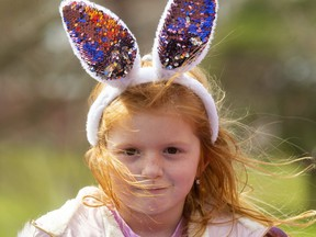 """Scarlet Baratta, 5, knows she's the centre of attention with her """"Easter ears"""" as she plays at the Springbank Park playground in London. Mike Hensen/The London Free Press"""