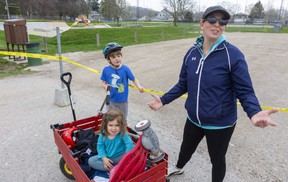 """A frustrated Rebecca Rickwood of Port Stanley brought her kids to the local skatepark Sunday hoping son Rhys, 5, could practise on his new scooter and daughter Rylee, 2, could burn off some energy. """"Maybe they don't work on Sunday,"""" she said. """"First, they close (playgrounds) then they open them, it's very frustrating because my kids still have all their energy."""" (Mike Hensen/The London Free Press)"""