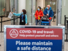 Travellers from an international flight are directed to the COVID-19 testing area as part of Canada's measures against the coronavirus disease (COVID-19), at Toronto Pearson International Airport in Mississauga, February 24, 2021.