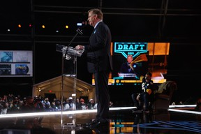 NFL Commissioner Roger Goodell announces a team's selection at the league's 2021 draft in Cleveland last week. (Getty Images)