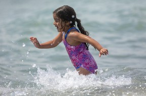 Aleena Sobh, 5, plays in the small waves in Lake Erie on the main beach in Port Stanley on Tuesday May 25, 2021. (Mike Hensen/The London Free Press)