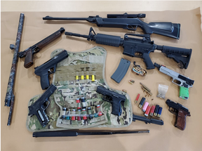 London police seized a pistol, replica firearms, ammunition and a small quantity of drugs in a search of a home on Oxford Street West on April 30. Police are searching for a 48-year-old London man who faces three weapon and drug charges. (London police photo)