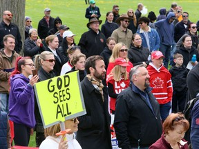 Independent MP Derek Sloan, front row, centre, listens during an anti-lockdown protest Monday, April 26, 2021, at Tecumseh Park in Chatham. (Mark Malone/Chatham Daily News/Postmedia Network)