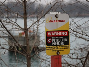 A sign marks the Enbridge Line 5 pipeline on the Canadian side of the St. Clair River. Central Canada and Michigan are in a standoff about this pipeline which carries 540,000 barrels of Western Canadian oil through a U.S. shortcut on the south side of the Great Lakes.