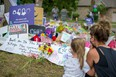 People gather June 12 at a makeshift memorial on Hyde Park Road in London where four members of a London Muslim family were killed in what police describe as a hate-motivated attack. REUTERS/Alex Filipe