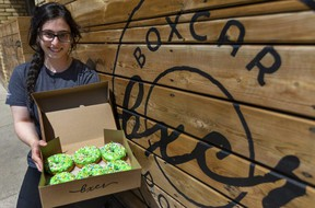 Joan Omar of Boxcar Donuts shows green sprinkled doughnuts the shop is selling to raise money in the name of the London family struck by a truck while out for a walk on Sunday night in London. Police say the driver targeted the family in the collision that killed four members and injured a fifth because they were Muslim. The #OurLondonFamily doughnuts sell for $3.25 each and proceeds are donated to a GoFundMe page created with permission of the family. (Mike Hensen/The London Free Press)