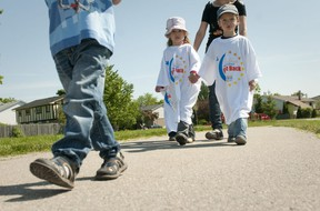 Kayla, 4, left, and Kailer, 5, right, hold hands as they walk around Ashley Oaks Public School while taking part in a mini Relay for Life in London on Friday June 3rd, 2011.  (Free Press file photo)