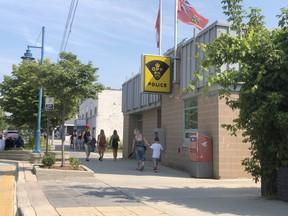 Tourists walk past Lambton OPP headquarters in Grand Bend on Wednesday. The OPP issued a public warning after three alleged incidents involving strangers approaching young children. Terry Bridge/Sarnia Observer/Postmedia Network