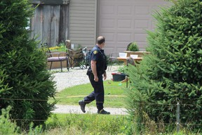OPP officers remained on the scene Tuesday at a home in Port Burwell, where five family members, including three children, were seriously injured in a fire pit mishap. (DALE CARRUTHERS/The London Free Press)