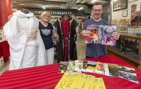 Carol Vandenberg and Gord Mood,  co-owners of L.A. Mood, get ready Wednesday, Aug. 11, 2021, for free comic book day Saturday in London. They will have cosplay outfits for photos as well as free comics to get new readers interested. (Mike Hensen/The London Free Press)