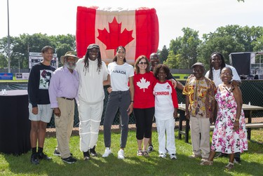 Miranda Ayim and her family are joined by the McAuley family during the city celebrations for returning Olympians held in Labatt Park on Saturday August 28, 2021.  Mike Hensen/The London Free Press/Postmedia Network