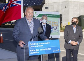 Ontario Minister of Energy Todd Smith makes an announcement in the West 5 neighbourhood of London. With him are Mayor Ed Holder (right) and Richard Sifton, president and CEO of Sifton Properties. (Derek Ruttan/The London Free Press)