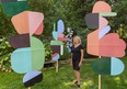 London artist Deborah Worsfold stands surrounded by her Three Graces, large art pieces in her backyard in London. Worsfold is hosting an open house this weekend to allow the public to view 16 of her large pieces, called maquettes, and other paintings and collages in her studio and home.  (Mike Hensen/The London Free Press)