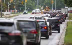 Repairs to a traffic light at Wonderland and  Springbank, which block the left turn lane, have left Wonderland jammed with traffic southbound in London, Ont. (Mike Hensen/The London Free Press)