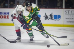 Windsor's Wyatt Johnston battles London's Gerard Keane for the puck during OHL action between the Windsor Spitfires and the London Knights at the WFCU Centre, on Monday, Oct. 11, 2021.  (DAX MELMER/Postmedia Network)