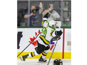 London Knights forward Landon Sim celebrates, and so do the back-at-the-rink fans, after scoring in the second period of their OHL game against the Owen Sound Attack at Budweiser Gardens in London on Friday October 8, 2021.Derek Ruttan/The London Free Press