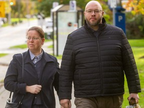 Herbert Hildebrandt and his wife walk into court at the Elgin County Courthouse in St. Thomas on Friday October 22, 2021. Herbert is son of firebrand reverend Henry Hildebrandt and has been charged with assault. (Mike Hensen/The London Free Press)