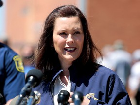Michigan Governor Gretchen Whitmer addresses the media in downtown Midland, Michigan, May 20, 2020.