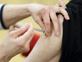 Needle into arm at the COVID-19 vaccination supersite at RBC Convention Centre in downtown Winnipeg on Monday, March 1, 2021.