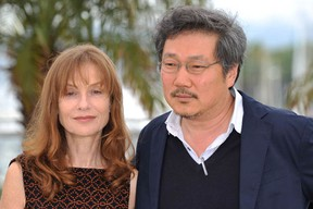 Actress Isabelle Huppert and South Korean director Hong Sang-soo at  photocall for In Another Country,  the 65th Annual Cannes Film Festival at Palais des Festivals on May 21, 2012 in Cannes, France.  The film will be shown at Montreal's Festival du Nouveau Cinema 2012. (Gareth Cattermole/Getty Images)