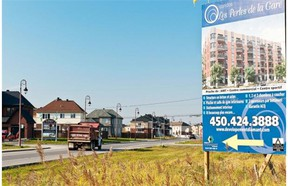 Signs announce the erection of a new mixed residential development consisting of houses, apartments and condos at Plaza Chartrand, in Vaudreuil.