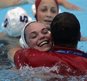 Canada's Christine Robinson hugs Ahmed El-Awadi, then, assistant coach, after Canada's bronze medal win over Russia at 2005 FINA championships in Montreal.