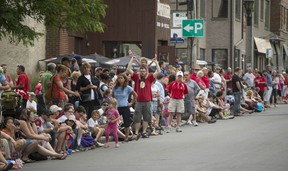 A large crowd lined Lakeshore Road. in the village.